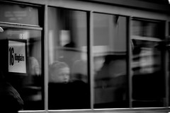 16 Ringbahn (aluedt [off for a while finishing my phd]) Tags: boy shadow urban blackandwhite distortion motion blur reflection monochrome lines germany geometry perspective tram diagonal passenger 16 passing bremen sixteen ringbahn