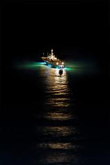 Lost In The Dark (Charn High ISO Low IQ) Tags: nightphotography sea canon dark lost eos boat dubai uae floating jbr 600d driftingaway utterdarkness