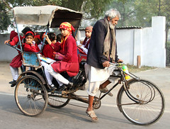 School Bicycle (cowyeow) Tags: road street city morning travel school girls red portrait india girl smile car bike bicycle kids youth children funny uniform candid indian young smiles agra oldman commute littlegirl cart carry overload overloaded loaded crowded girlsschool uttarpradesh girlschool reduniform funnyindia