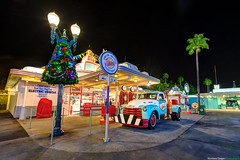Oscar's Service Station (TheTimeTheSpace) Tags: night pumps gas christmaslights palmtrees disneyworld cocacola wdw waltdisneyworld hdr towtruck d800 hollywoodstudios hdratnight 142428 oscarsservicestation