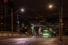 Into Focus (Fulcrum imaging Robert Greatrix) Tags: city longexposure bridge urban toronto blur night train cityscape riverside ttc sony sigma structure nightscene streetcar 70200 sonycamera 2012 urbanlandscape slowshutterspeed copyrighted sigmalens canadianphotographer queensteast torontophotographer sonyalpha sonydslr robertgreatrixphotography