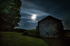 Moonlight Farm No. 2 (Geoffrey Coelho Photography) Tags: lighting old light summer sky building abandoned night clouds barn rural buildings dark landscape outside rainbow soft glow outdoor farm rustic barns scenic fullmoon moonlit moonlight glowing moonbow moonspooky