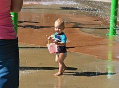 Hi Mommy, I'm Getting Wet Now! . (ikan1711) Tags: boy littleboy toddler water waterscenes waterdrops waterpark children allchildren smallchildren cutechildren bucket sprinklers outdoors himommyimgettingwetnow johnlawsonpark ambleside west vancouver