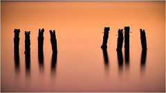 Silent pylons at sunset (Chas56) Tags: sunset pylons jetty pier remnants structure cliftonsprings canon canon5dmkiii ndfilter ndphotography longexposure longexposurephotography water beach sea seaside eight silhouette silouettes