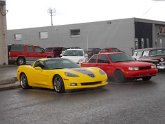 Here Comes the Rain Again (blondygirl) Tags: showshine car auto celebrationchurch june19 fathersday carshow 15thannual yeg sa 2016 antiquecars sportcars musclecars imports trucks motorcycles raindrops red yellow  chevrolet corvette