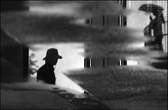 F_DSC6511-BW-Nikon D800E-Nikkor 28-300mm-May Lee  (May-margy) Tags: maymargy bw          cementfloor puddle reflection        taiwan repofchina fdsc6511bw portrait silhouette glass raining   umbrella verticalflip blur bokeh   keelungcity nikond800e nikkor28300mm maylee