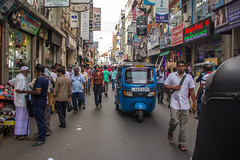Bustling Streets of Pettah (Nazly) Tags: colombo traffic srilanka people street tuktuk pettah fort streetphotography pavement seller sign tuk bustle