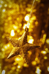 Christmas decoration. Star with light background. Toned to gold. (hoboton) Tags: christmas new xmas holiday blur color macro yellow closeup toy gold star golden design still shiny december bokeh decorative background object year decoration nobody newyear sparkle gift tradition toned decor tone