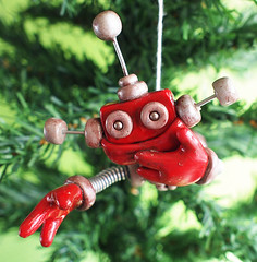 Rustic Red Reba Robot with Jetpack Christmas Ornament (HerArtSheLoves) Tags: christmas xmas fiction sculpture cute smiling robot miniature flying mixed wire media geek heart handmade oneofakind ooak happiness science ornament clay hanging handcrafted soaring jetpack coiled polymer theawesomerobotscom