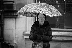 Umbrella... (alfie2902) Tags: street nottingham uk people urban bw monochrome mono blackwhite pentax availablelight candid streetphotography streetportrait k5 da40limited smcpentaxda40mmf28limited blackwhitestreetphotography alfie2902