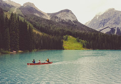 trio in emerald. (theperplexingparadox) Tags: travel lake canada travelling nature forest canon landscape rockies boat waves bc kitlens canoe kayaking canoeing 1855 watersports paddling moutains emeraldlake outdooractivities waterripples canon400d