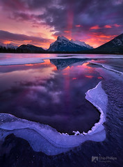 Rundle Sunrise vertical (Chip Phillips) Tags: sun reflection ice sunrise rockies frozen lakes canadian mount rays vermillion rundle banffnationalparkwinteralbertacanada