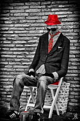 Invisible man loves red (Alessandro Giorgi Art Photography) Tags: red bw man rome colour roma muro hat wall blackwhite chair nikon sitting colore invisible bricks tie bn pillow uomo ama loves rosso sedia biancoenero cappello selective buildingblocks invisibile mattoni amare cravatta seduto cuscino selettivo d7000