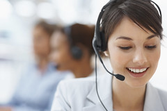 Smiling call center employee during a telephone conversation (billyaustindallas) Tags: people woman blur girl beautiful beauty smile face up smiling closeup modern female work happy person corporate office women call looking close adult background space working young talk center fresh headset professional communication business attractive customer service worker conversation copyspace secretary talking executive success copy colleague operator employee teamwork caucasian