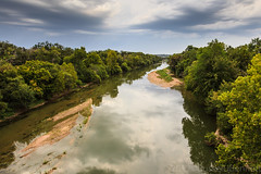 Colorado River north of La Grange, TX (Russell J Bennett) Tags: trees plants usa weather clouds texas unitedstates cities bridges places rivers coloradoriver lagrange