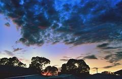 Stormy dusk (YAZMDG (15,000 images)) Tags: sky tree clouds silhouettes stormy roofs powerlines ciel nuages yaz yazmdg ystudio yazminamichledegaye