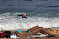 Drone View (coqrico) Tags: ocean camera sea woman beach girl lady female digital photography flying video seaside view flight aerial rico bikini shore vista midair seashore sneaky recording camcorder hovering hover sneaking sneak videotaping drone aloft gopro leffanta