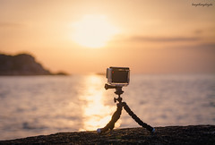 Taking Timelapse Video (langthangdaydo) Tags: ocean trip travel sea cliff sun seascape beach water sunshine yellow rock stone sunrise movie island coast timelapse video seaside asia dof waterfront bokeh stones explorer wave peak vietnam adventure explore traveling taking milestone eastsea traveler seawater gopro