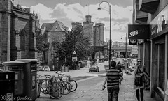 In the distance Newcastle Castle. (steve.gombocz) Tags: newcastle street castle bw monochrome greyscale urbanstreet blacknwhite streetscenes streetscene blackwhite whiteblack bwphotos bwstreetscenes bwstreet flickrbw bwflickr blackwhitephotos blackwhitephotography flickrstreet blackandwhitestreet bwstreetphotography streetlife balckandwhite streetphotographs bwphotographs streetphotography bwphotography noiretblanc schwartzundweiss negroyblanco zwartwit neroebianco sortoghvid mustavalkoinen svarthvitt svartoghvitt svartochvitt czarnyibiaty pretoebranco noirblanc schwartzweiss negroblanco nerobianco pretobranco olympusmzuiko25mmf18lens olympususers olympusdigitalcamerausers olympusbw micro43rdsuk olympuszuikodigitalclub olympuseurope flickrblackandwhitephotos olympusem5mark2 olympusm25mmf18 newcastlebw newcastlemonochrome newcastlescenes newcastlephotographs newcastleblackwhite tuttiicoloridelnero