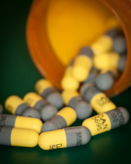 Handle with Care (Explored) (lclower19) Tags: capsules medicine medication macromondays handlewithcare yellow grey macro closeup explored