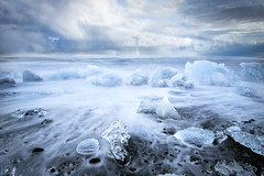 Quicksilver (Ffotograffiaeth Dylan Arnold Photography) Tags: ice sea ocean icebergs iceland water glacial glacier lagoon cold sunset seascape frozen landscape blocks rainbow clouds sky waves blue textures colours serene tranquil