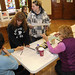 Election inspectors Elaine Lemieux and Mae LaMare give direction to voters Tammy Rice and Nicole LaPlante as they get their ballots for District 5 at the Adirondack Adult Center in Tupper Lake. Photo: Mark Kurtz