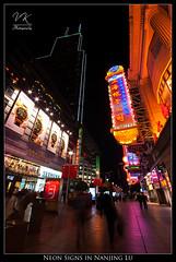 Neon Signs in Nanjing Lu |  (VK | Photography) Tags: china road street light orange sign night skyscraper shopping dark nikon neon purple shanghai angle 10 wide sigma mm framing   nanjing 1020 lu  f456 sigma1020mmf456  d80 portraitorientation shimaointernationalplaza eastnanjinglu