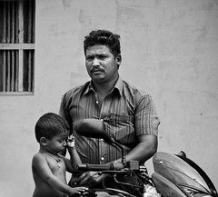 | Boothipuram (Kals Pics) Tags: life people blackandwhite bw window monochrome bike canon blackwhite kid child candid father culture son colorless pulsar tamilnadu villagepeople cwc villagelife rurallife teni relation ruralindia indianvillages 550d theni ruralpeople villagephotography kalspics 18135mmis chennaiweelendclickers  boothipuram