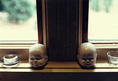 Split Personality (CrystalFilm) Tags: baby film canon vintage pepper lomo warm grain salt eerie creepy heads haunting tones knick knacks t50 lomgraphy