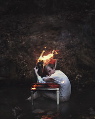 Igniting nightmares. (David Talley) Tags: rotting forest river fire photography scary eyes chair woods zombie evil surreal burning burn demon match nightmare conceptual flaming conceptualphotography davidtalley ignitingnightmares