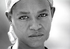Portrait of a young Ethiopian woman (foto_morgana) Tags: africa portrait people beauty face female outdoors looking serious african character posing stare afrika omovalley ethiopia bandana portret nikoncoolscan analogphotography afrique blackwoman ethiopian perspiration blackwhitephotography hoofd kerchief femelle humanhead humanface vrouwelijk persoonlijkheid karakter analogefotografie vuescan nomodelrelease ethiopi caractre photographienoiretblanc couvrechef facefront zwartwitfotografie hosaina faceinfront ttehumaine kodaktmax400cn omovallei valledelomo photographieanalogue editorialonly vallebajodelomo facialsweat