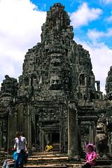 Bayon (lostsoulx80x) Tags: travel blue sky people face stone clouds temple cambodia southeastasia khmer gray siemreap angkor bayon angkorthom pinklady buddhastatue mahayanabuddhism toutists canon450d kingjayavarmanvii lokevara earthasia giantsmilingfaces