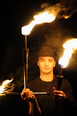 A portrait with torches (Derbeth) Tags: torch torches portrait d5000 nikkor35mmf18 rawtherapee flame fire night juggling