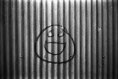 Laughing? (Purple Field) Tags: leica m3 rangefinder summarit 40mm f24 minilux fuji neopan iso400 presto bw monochrome film analog 35mm jakarta indonesia street alley walking graffiti