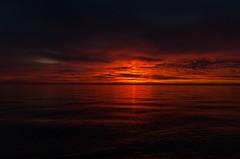 RedDawn (jmishefske) Tags: red lakeshore 2014 sun sunrise shore lakefront september wisconsin pentax k01 park milwaukee downtown county lakemichigan