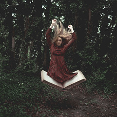Storytime (laurawilliams) Tags: book dress woods forest surreal surrealism trees alice wonderland story stories jump float levitate