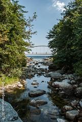 Strolling Over Merging Waters (onemoregeorge.frames) Tags: 2016 agiosioannis august d40x greece nikon pelio bridge omg onemoregeorge river riverbed rocks sea summer water