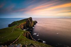 Sunset at Neist Point Lighthouse, Skye (modesrodriguez) Tags: neist point lighthouse sunset scotland skye island highlands westskye sky orange sun colors cliffs water longexposure