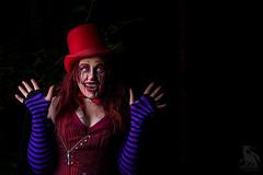 Surprise (CJ Schmit) Tags: wwwcjschmitcom 5dmarkiii canon canon5dmarkiii cjschmit cjschmitphotography canonef85mmf18usm photographermilwaukee milwaukeephotographer photographerwisconsin dragonspitstudios clown amberrobinson female model woman teeth corset tophat gloves dark evil evilclown red whiteeyes scarry frightening helloween halloween forest hawthornglen milwaukeecountyparks park bowtie alienbeeb800 fotodioxprostudio60 octo softboxpocket wizards milwaukee wisconsin