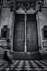 They live among us (Channz) Tags: toledo espana spain monochrome europe traveller thetraveller cathedral channy church travel blackandwhite architecture indoor longexposure spooky puerta doors puertas tiles ghosts