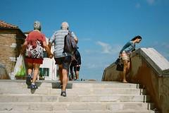 Venice 06.2015 #film #nikon #f55 #50mm #streetphotography #footsteps #traveling  #italy #venice #bluesky #oldcouple #younglady (man.cheukhim) Tags: instagramapp uploaded:by=instagram film nikon f55 50mm streetphotography footsteps traveling italy venice bluesky oldcouple younglady