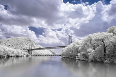 Bear Mountain Bridge In Infrared (Mike Orso) Tags: travel bridge ny newyork reflection metal clouds print ir photography photo scenery gallery unitedstates image cloudy fineart stock scenic picture canvas bearmountain filter license infrared hudsonriver falsecolor 720nm highlandfalls invisiblelight convertedcamera whitefoliage mikeorso