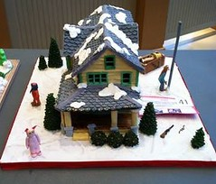 """""""A Christmas Story"""" Gingerbread House (Mary Figueroa: Cakes & more) Tags: christmas trees roof winter red house holiday snow cute bunny ice lamp up yellow tongue movie fun lights glasses funny gun cookie village box weekend character flag leg gingerbread cream royal ears pole celebration suit story shade figure randy icing prairie siding bb chirstmas ryder bushes fragile flick conner cones bundled 2012 ralphie fondant elaborate gumpaste"""