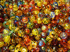Bright Colors against dreary November Weather (Batikart) Tags: blue red summer orange green glass colors lines yellow closeup canon germany geotagged toy outdoors deutschland mix focus europa europe colours dof market vibrant sommer stripes patterns collection colored leisure marbles choice rippled multicolored markt ursula onsale coloured assortment variation mixture 2012 murmeln sander g11 badenwrttemberg titisee helices largegroupofobjects mischung 100faves 200faves batikart canonpowershotg11