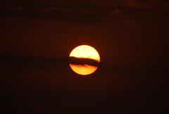dissection ([s e l v i n]) Tags: sunset cloud sun india bombay cutting mumbai fireball versova versovabeach ©selvin sunwithcloud