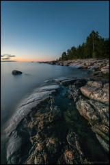 Cliffs (Jonas Thomn) Tags: cliffs klippor hav havet sea evening kvll storsand skog forest trees trd longexposure lngexponering filter nd400