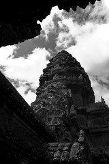 Cambodia - Angkor Temple (tamjty) Tags: travel sky blackandwhite white monochrome architecture clouds canon temple photography eos asia cambodia southeastasia vishnu khmer photojournalism dramatic buddhism angkorwat 7d blacks siemreap angkor hindu hinduism 1022mm journalism travelphotography f3545 khmerempire kingsuryavarman tamjty