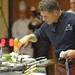 Chef Chiarello focuses on his dish