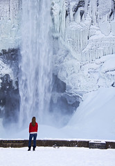 Winter Fall (Matt Champlin) Tags: life winter woman cold fall ice nature canon landscape outside outdoors amazing freezing falls icicle huge wife upstatenewyork chilly ithaca icy fingerlakes incredible towering 2012 taughannockfalls womaninred winterwaterfall