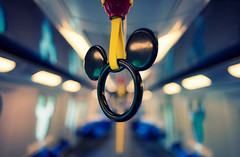 Riding on the Metro (isayx3) Tags: train 35mm subway mouse hongkong nikon hand metro bokeh disneyland empty railway disney mickey outoffocus ear strap f2 nikkor d800 oof isayx3 plainjoestudios plainjoephotoblogcom